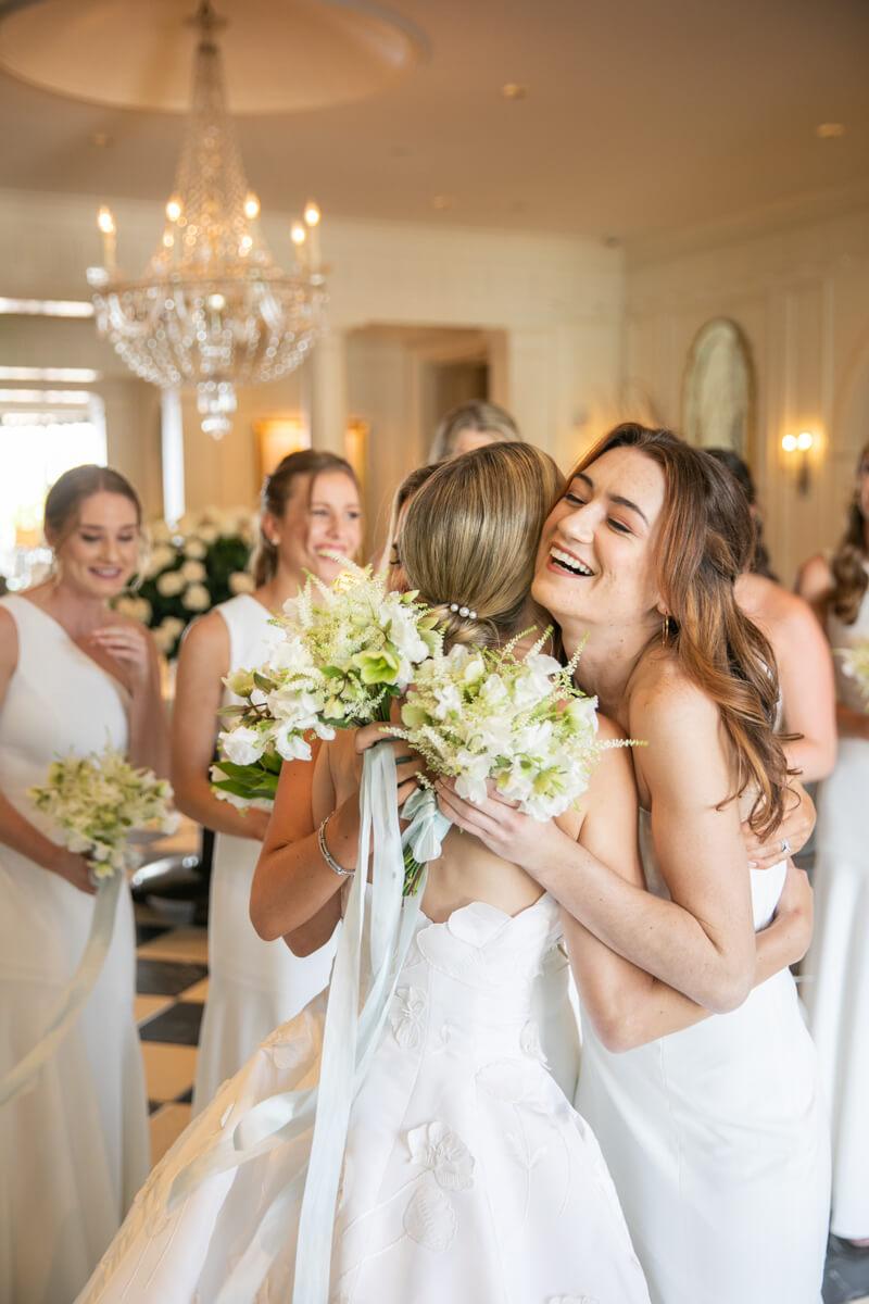 caitlin hugging bridesmaid