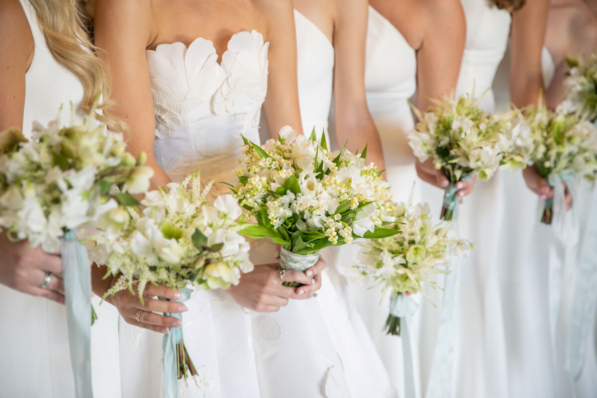 hands holding bouquets