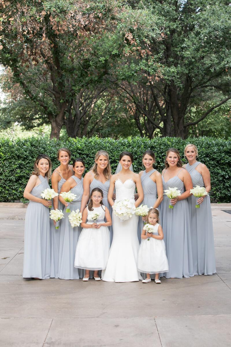 carey posing outdoors with bridesmaids