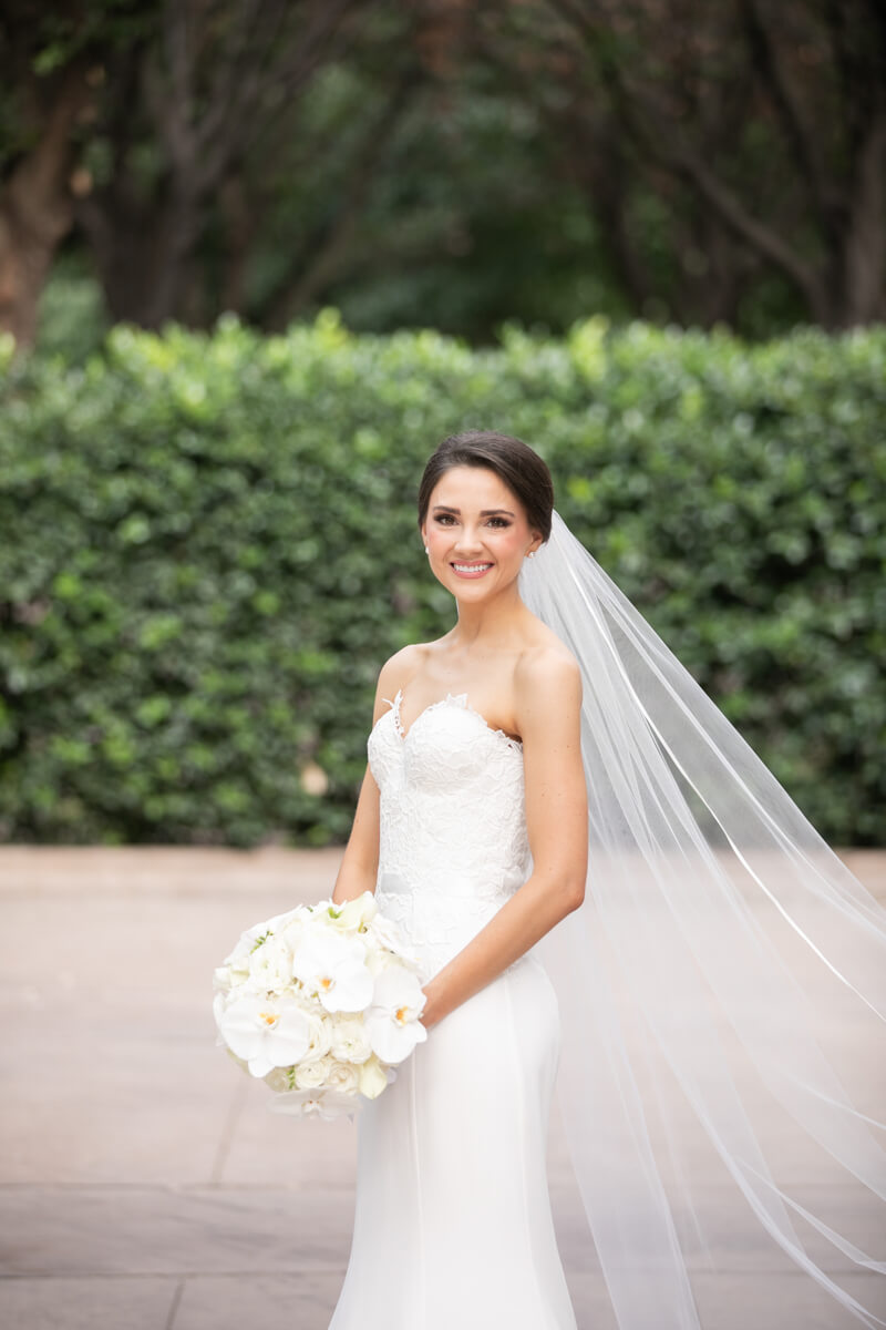 carey posing outdoors alone with veil