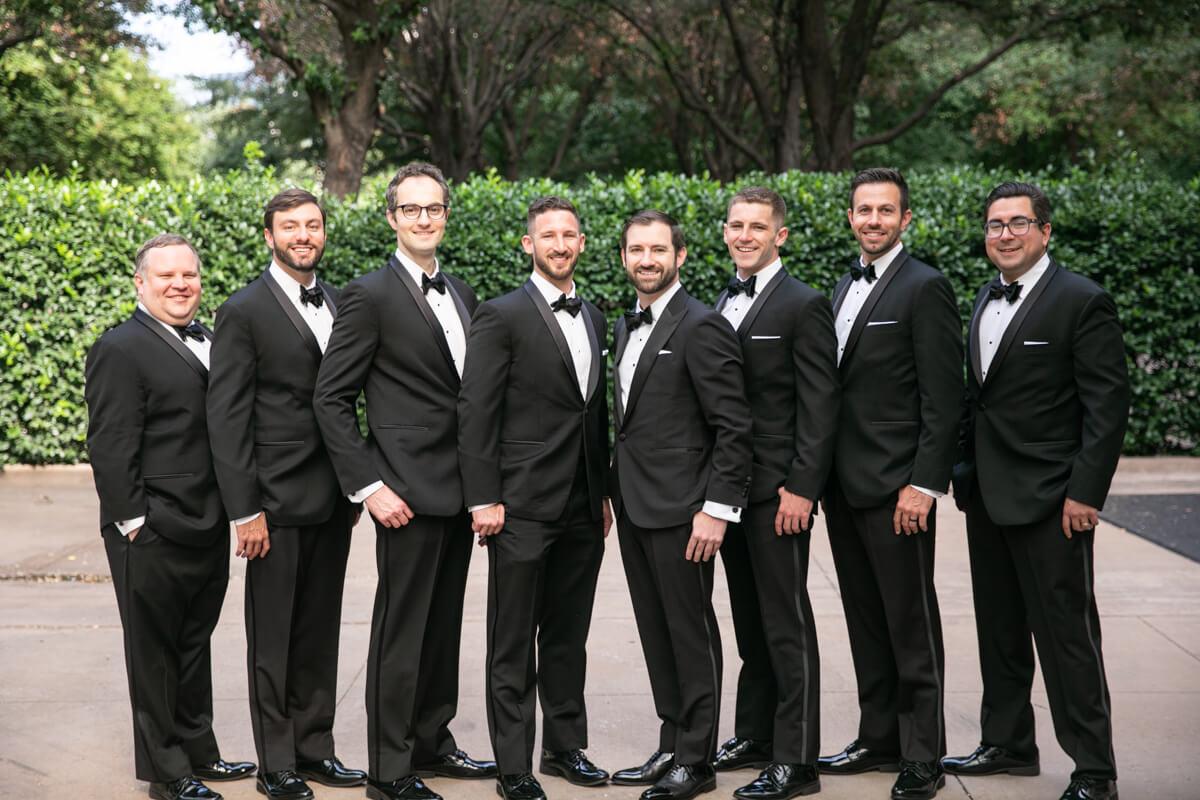 david posing outdoors with groomsmen
