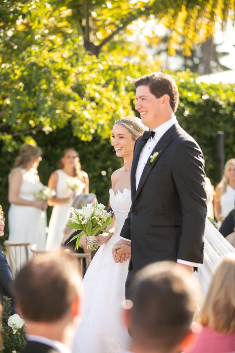 caitlin and geoffrey walking down the aisle