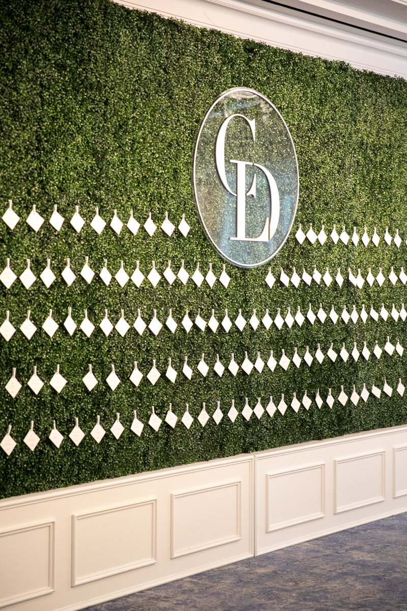 boxwood wall of escort cards