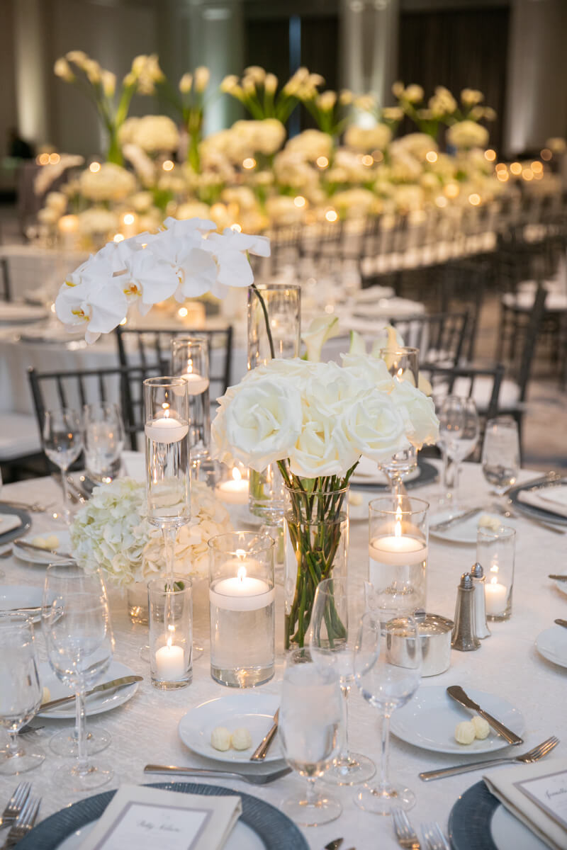 orchid and roses on a dining table
