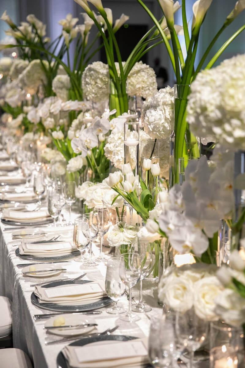 tiered white floral arrangements