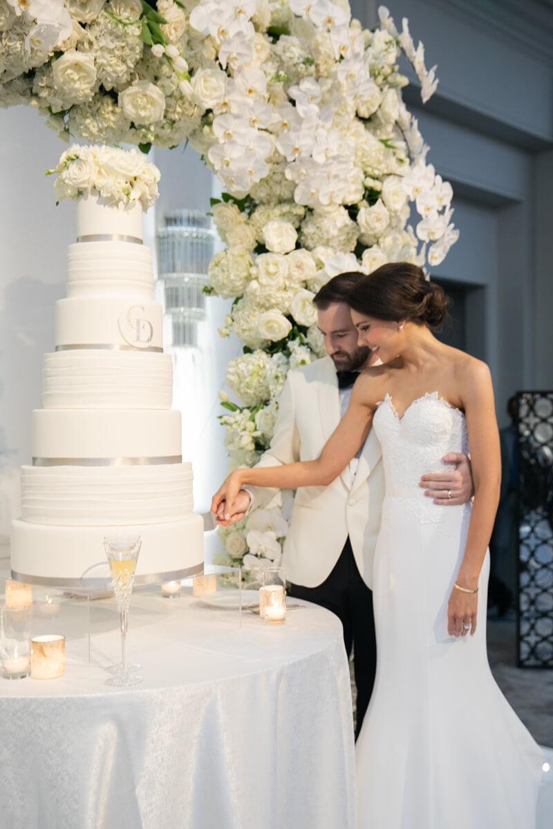 carey and david cutting their wedding cake
