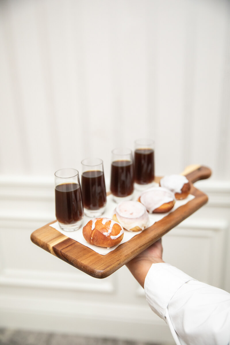 donuts and coffee on a tray