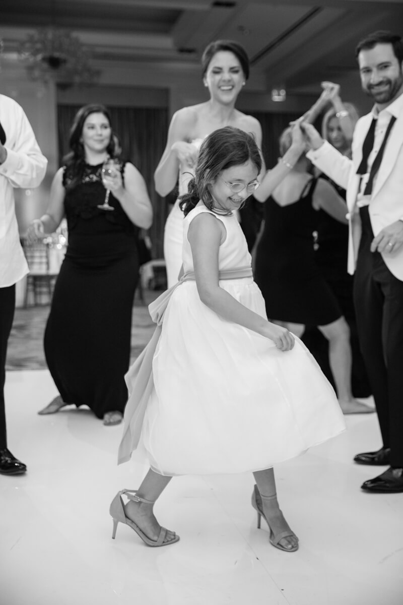 little girl dancing with some else's high heels on