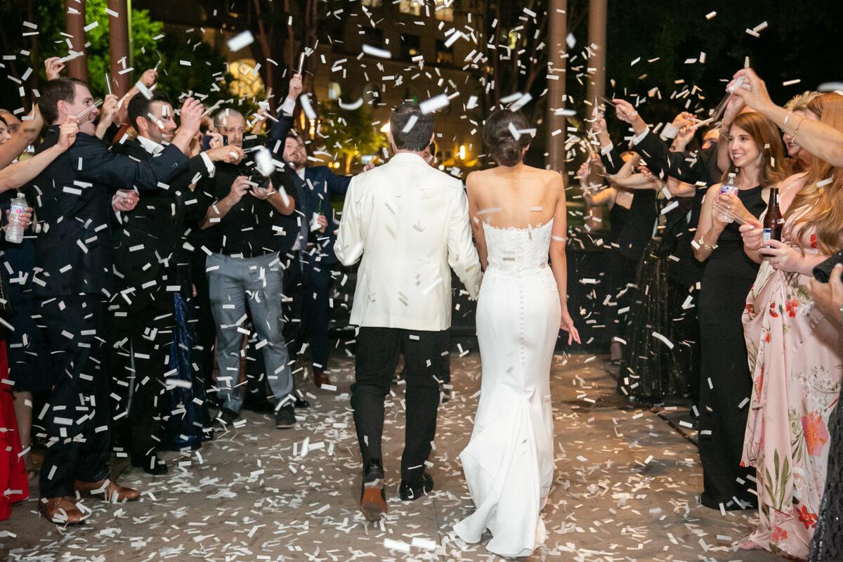 carey and david walking away through confetti