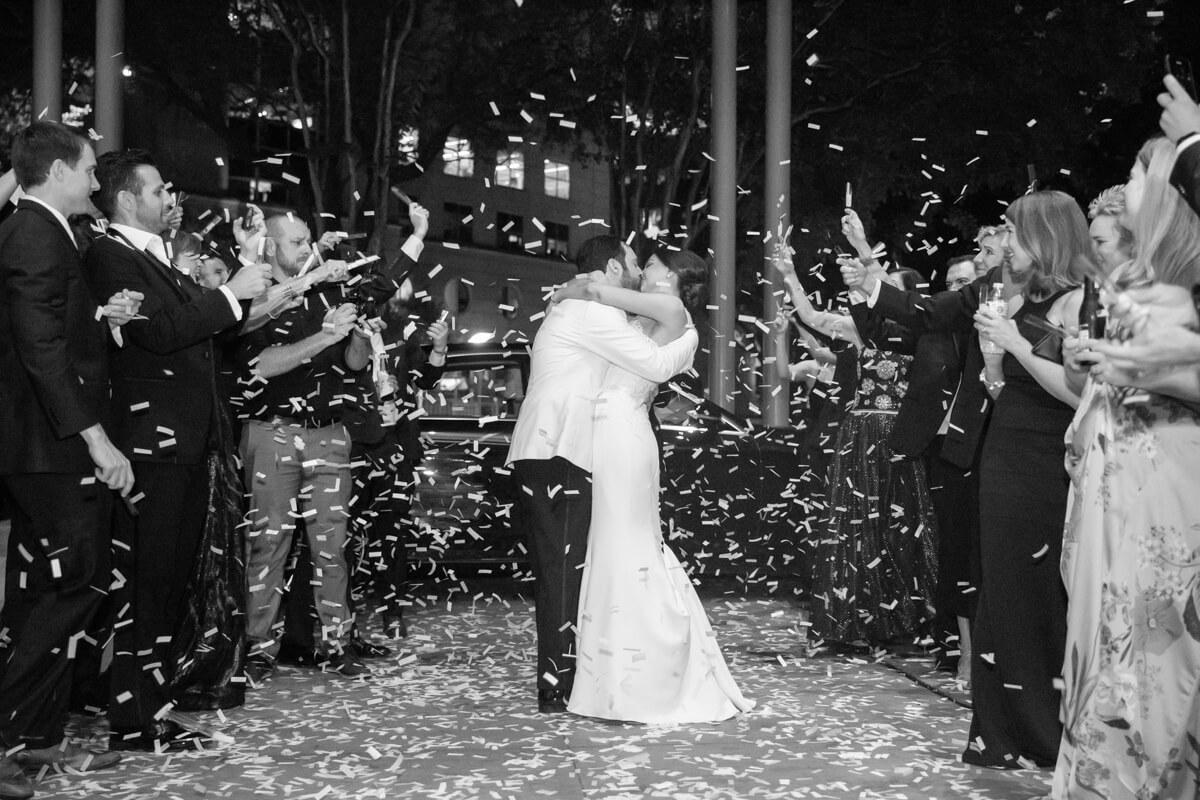 carey and david walking away and kissing through confetti