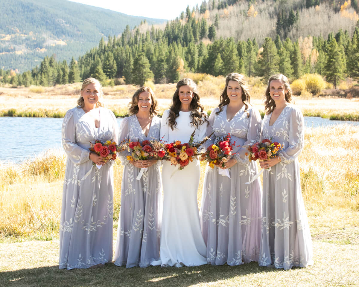 bride and bridesmaids in the mountains