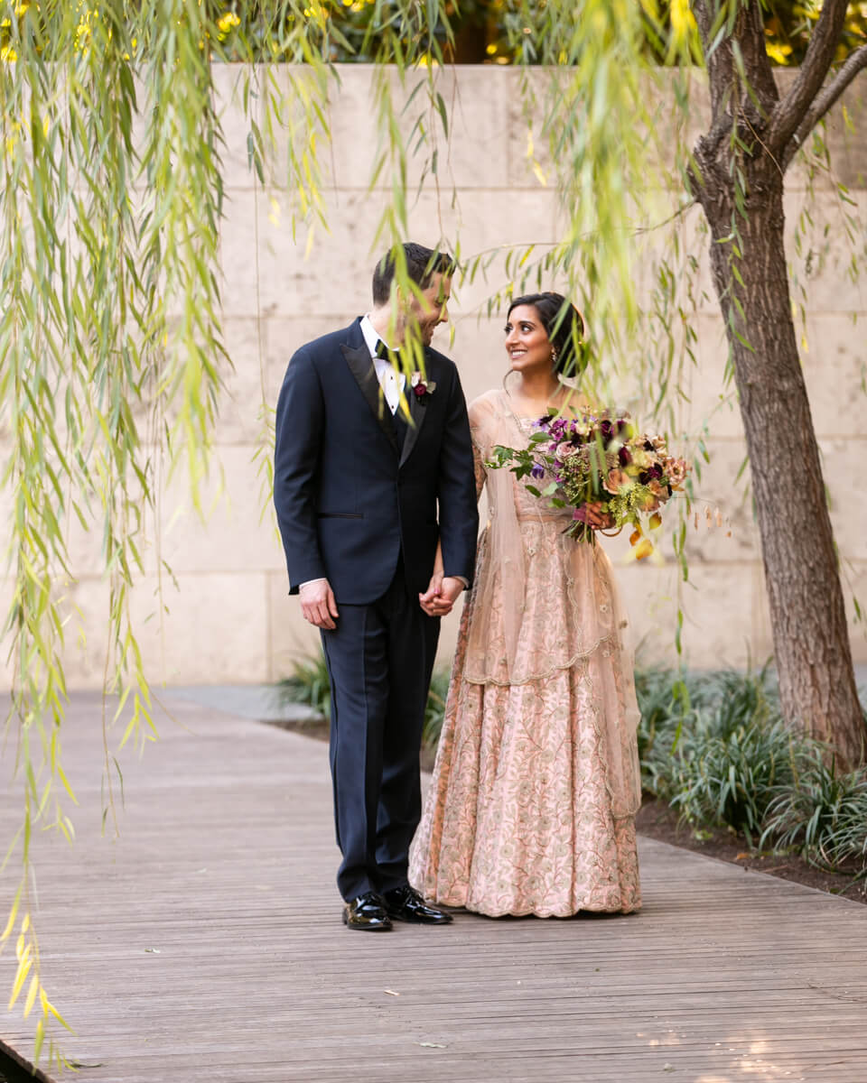 bride and groom walking through the Nasher