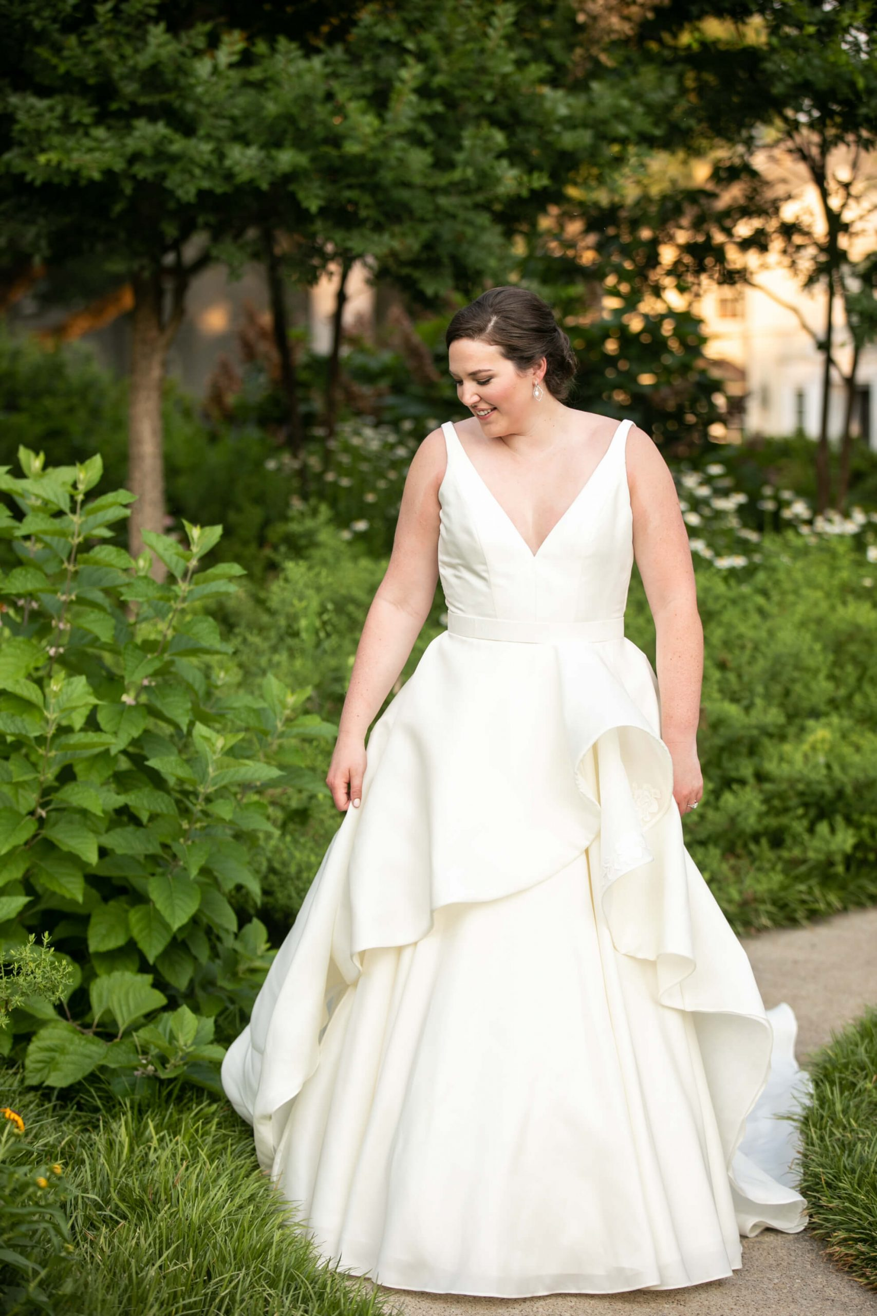 Carole Anne in her bridal gown in a park