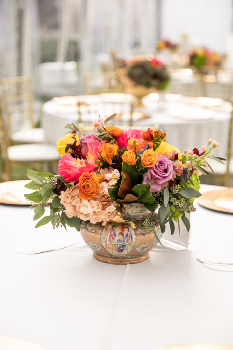 floral arrangement in gold pot