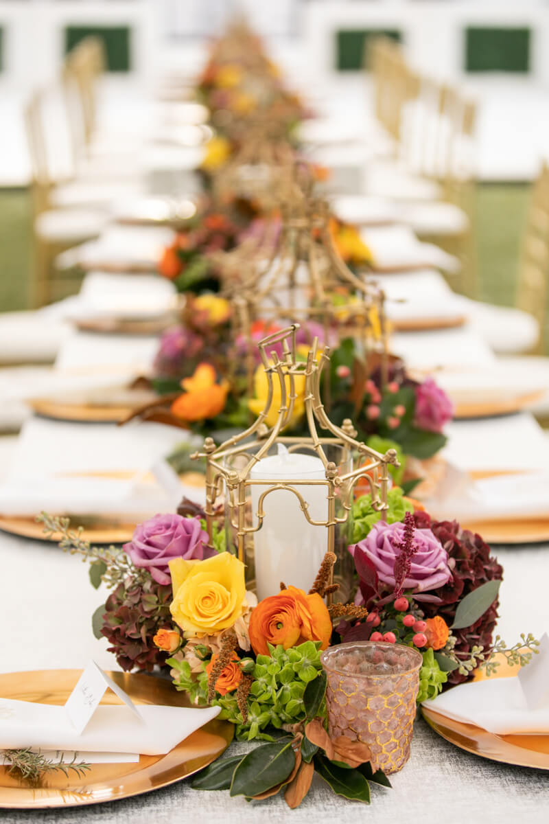 gold pagoda candle holders and fall florals