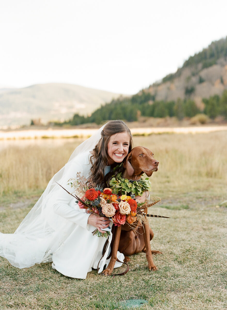 bride hugging her dog